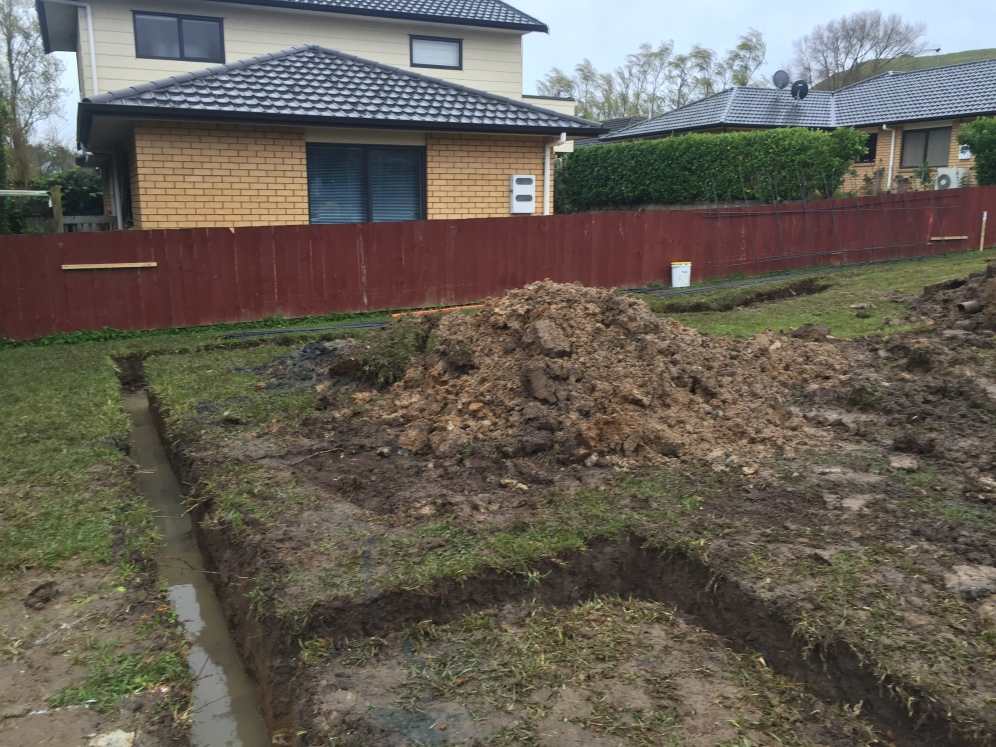 Digging out the footings/barrier for the House