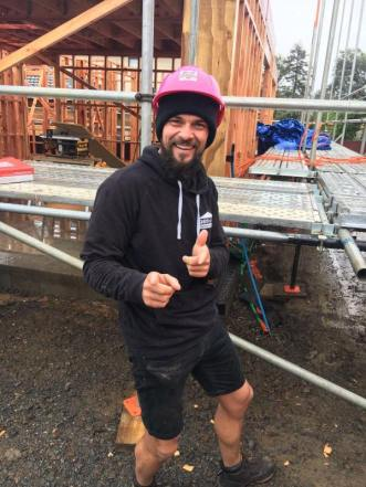 Martin rocking the pink hard hat when the framing arrived